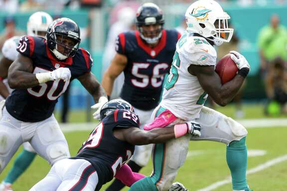 Miami Dolphins running back Lamar Miller (26) breaks away from Houston Texans strong safety Andre Hal (29) on his way to an 85-yard touchdown run during the second quarter of an NFL football game at Sun Life Stadium on Sunday, Oct. 25, 2015, in Miami. ( Brett Coomer / Houston Chronicle )