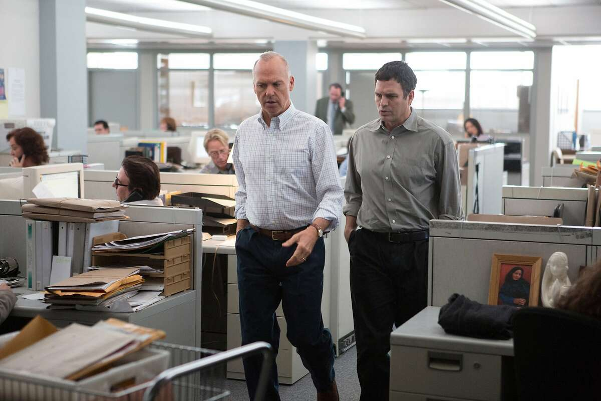 """This photo provided by courtesy of Open Road Films shows, Michael Keaton, left, as Walter """"Robby"""" Robinson and Mark Ruffalo as Michael Rezendes, in a scene from the film, """"Spotlight."""" (Kerry Hayes/Open Road Films via AP)"""