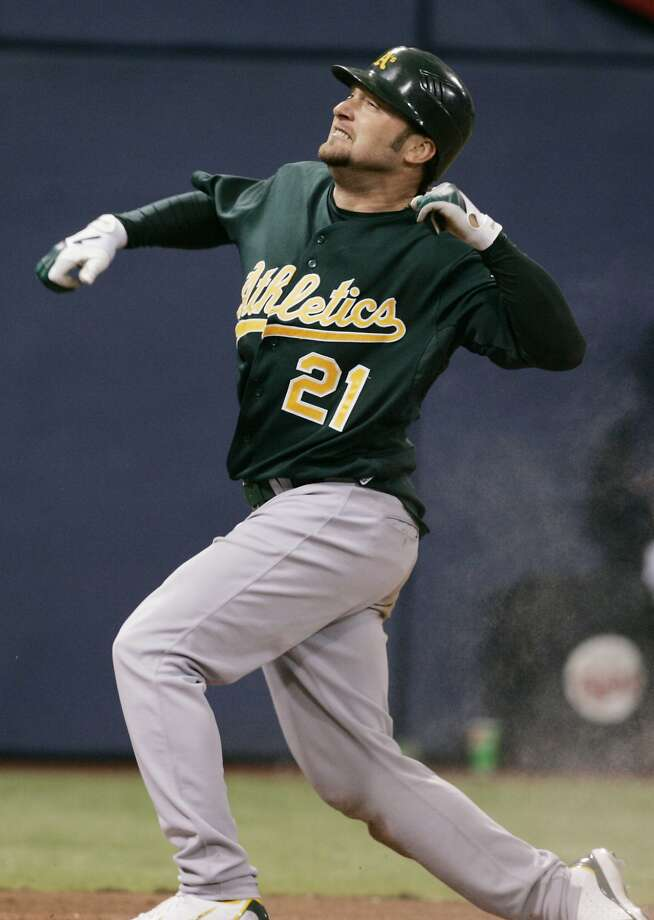 Oakland Athletics' Mark Kotsay celebrates his two-run inside-the-park homer off Minnesota Twins' Pat Neshek in seventh inning in Game 2 of the American League Division Series baseball game Wednesday, Oct. 4, 2006 in Minneapolis. (AP Photo/Jim Mone) Ran on: 10-08-2006 Photo: Jim Mone, AP