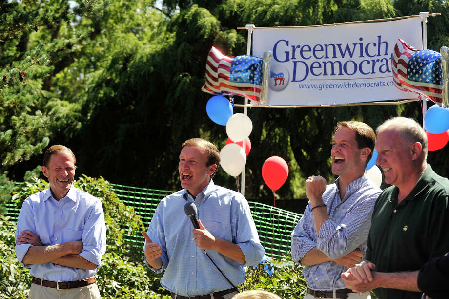 Sen. Chris Murphy, second from left, speaks as Sen. Richard Blumenthal, left, Rep. Jim Himes, second from right, and state Attorney General George Jepsen listen during the Greenwich Democratic Committee's annual campaign kick-off picnic in Greenwich, Conn., in September 2014. Photo: Jason Rearick / Jason Rearick / Stamford Advocate