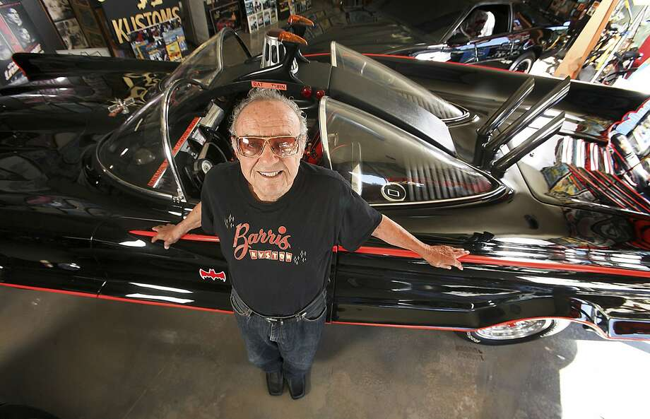 Car customizer George Barris stands next to his original Batmobile at Barris Kustom Industries in Los Angeles in 2012. It sold for $4.6 million in 2013. Photo: Mel Melcon, McClatchy-Tribune News Service