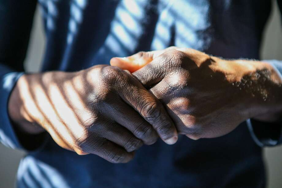 Veteran, Alfred Okonigbo rubs his hands together in his new apartment, at the Veterans Academy, in San Francisco, on Friday, November 6, 2015. Okonigbo, originally from Maryland, served in Afghanistan for four years. Photo: Gabrielle Lurie, Special To The Chronicle