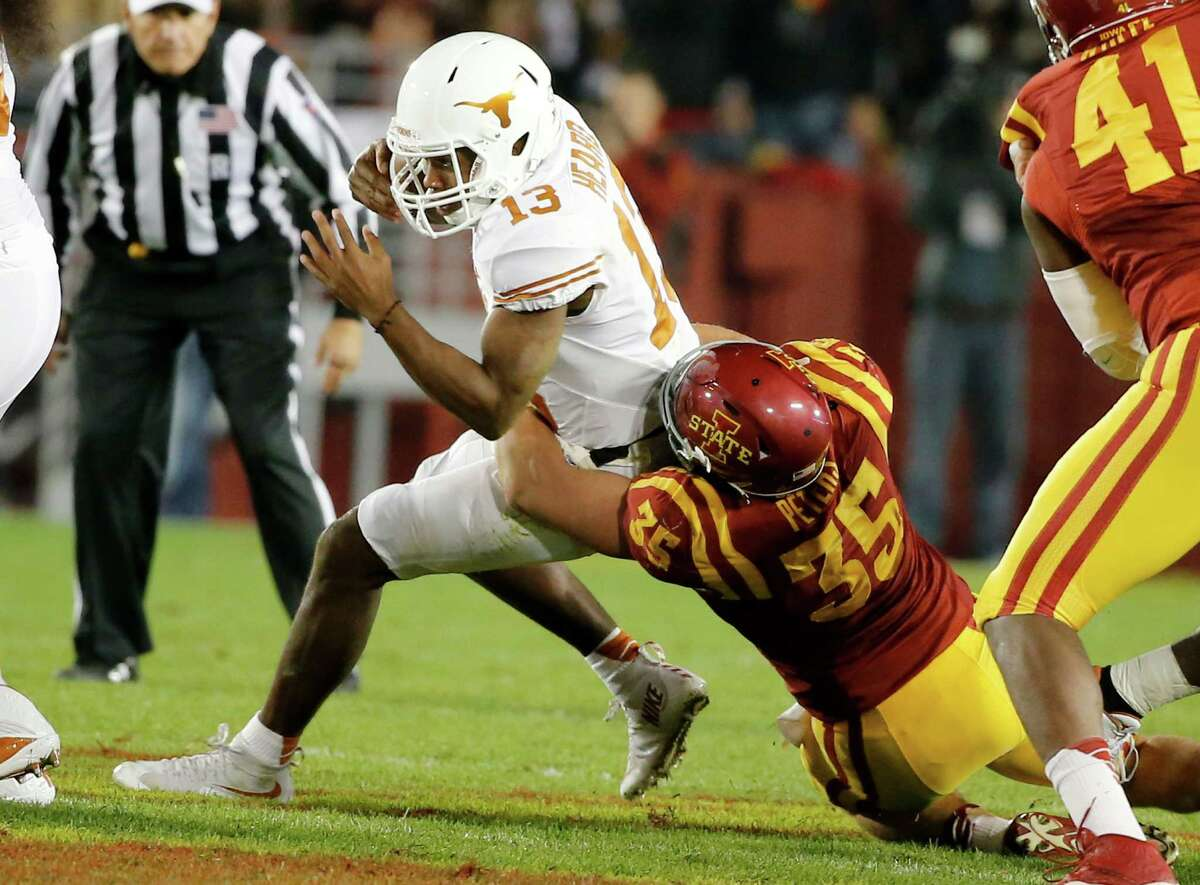 Linebacker Levi Peters of the Iowa State Cyclones sacks quarterback Jerrod Heard of the Texas Longhorns in the first half of play at Jack Trice Stadium on Oct. 31, 2015 in Ames, Iowa.