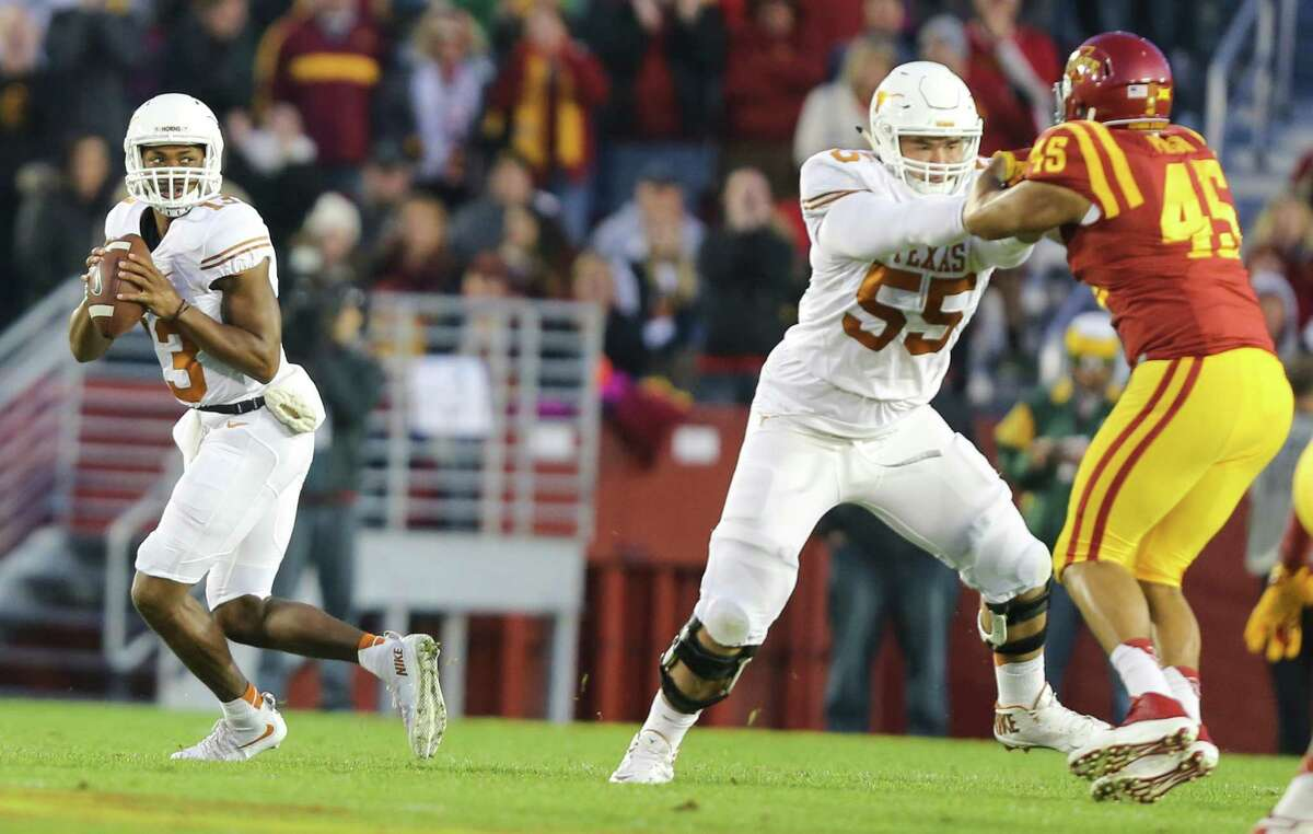 Texas quarterback Jerrod Heard looks down field for an open receiver during the first half against Iowa State on Oct. 31, 2015, in Ames, Iowa.