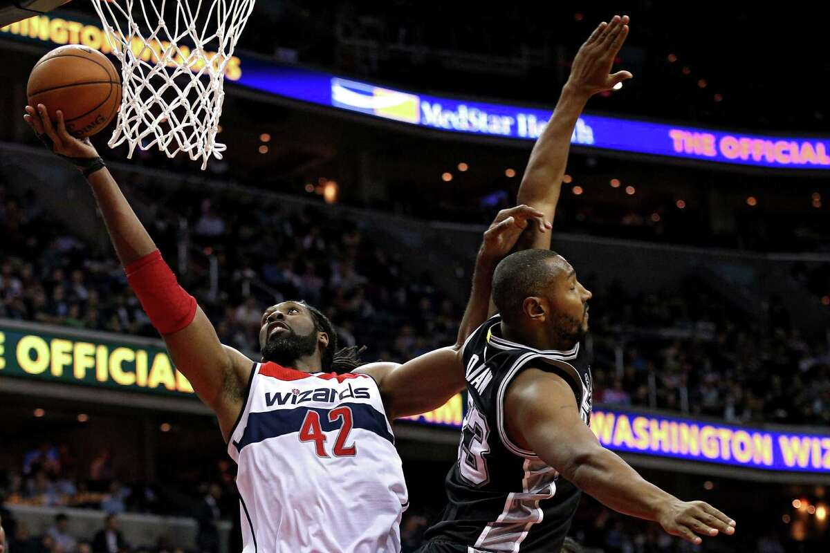 Nene of the Washington Wizards puts up a shot in front of Boris Diaw of the Spurs during the first half at Verizon Center on Nov. 4, 2015.