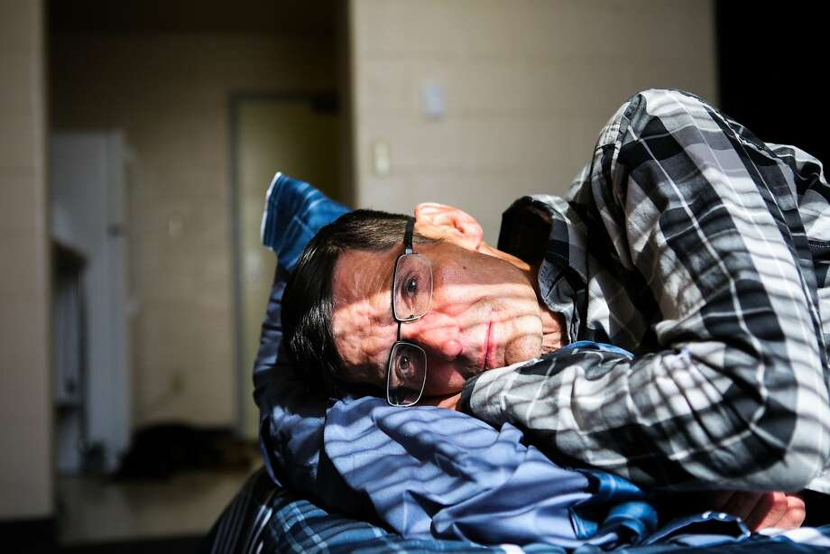 Veteran Patrick Parks, looks out the window of his new apartment at the Veterans Academy, in San Francisco, on Friday, November 6, 2015. He can't remember the last time he got really good sleep. Photo: Gabrielle Lurie, Special To The Chronicle