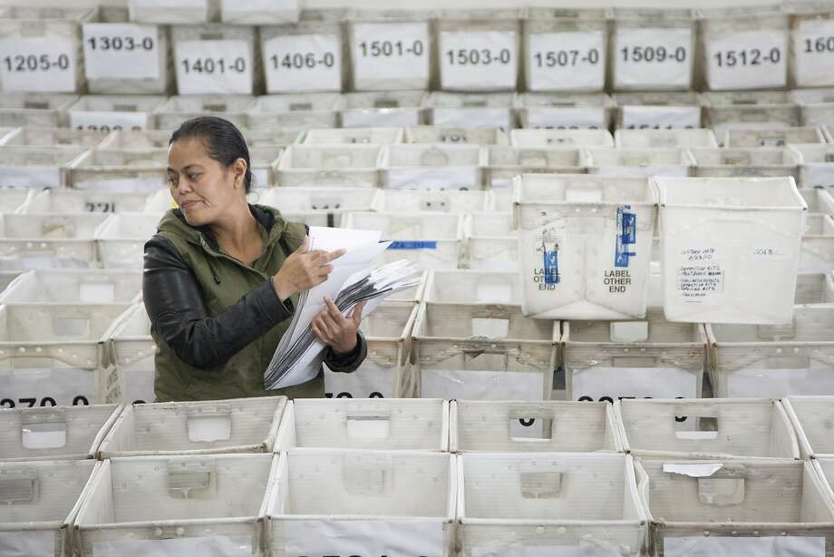 Lavinia Schaumkel organizes the all-mail election ballot information, Friday, Nov. 6, 2015, in San Mateo, Calif. Officials are expecting a higher voter turnout and believe an all-mail election is more convenient to voters. Photo: Santiago Mejia, Special To The Chronicle