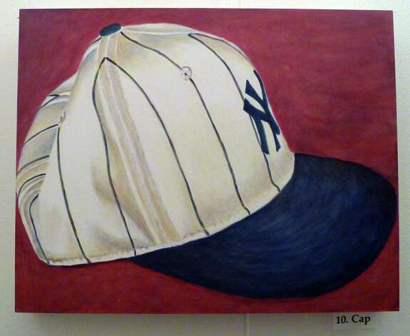 """Painting titled """"Cap"""" by Artist Lori Barraco Sylvester, who has an exhibit called """"pin stripes"""" featuring a series of painting showing the iconic Yankees uniform in Troy N.Y. Thursday May 24, 2012. (Michael P. Farrell/Times Union) Photo: Michael P. Farrell / 00017788A"""