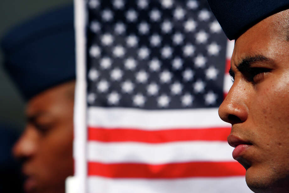 FOR METRO - U.S. Airforce Airman Christopher Hall (right) takes part in the ninth annual Veterans Day Parade Saturday Nov. 8, 2008. (PHOTO BY EDWARD A. ORNELAS/eornelas@express-news.net) Photo: EDWARD A. ORNELAS, STAFF / SAN ANTONIO EXPRESS-NEWS / eornelas@express-news.net