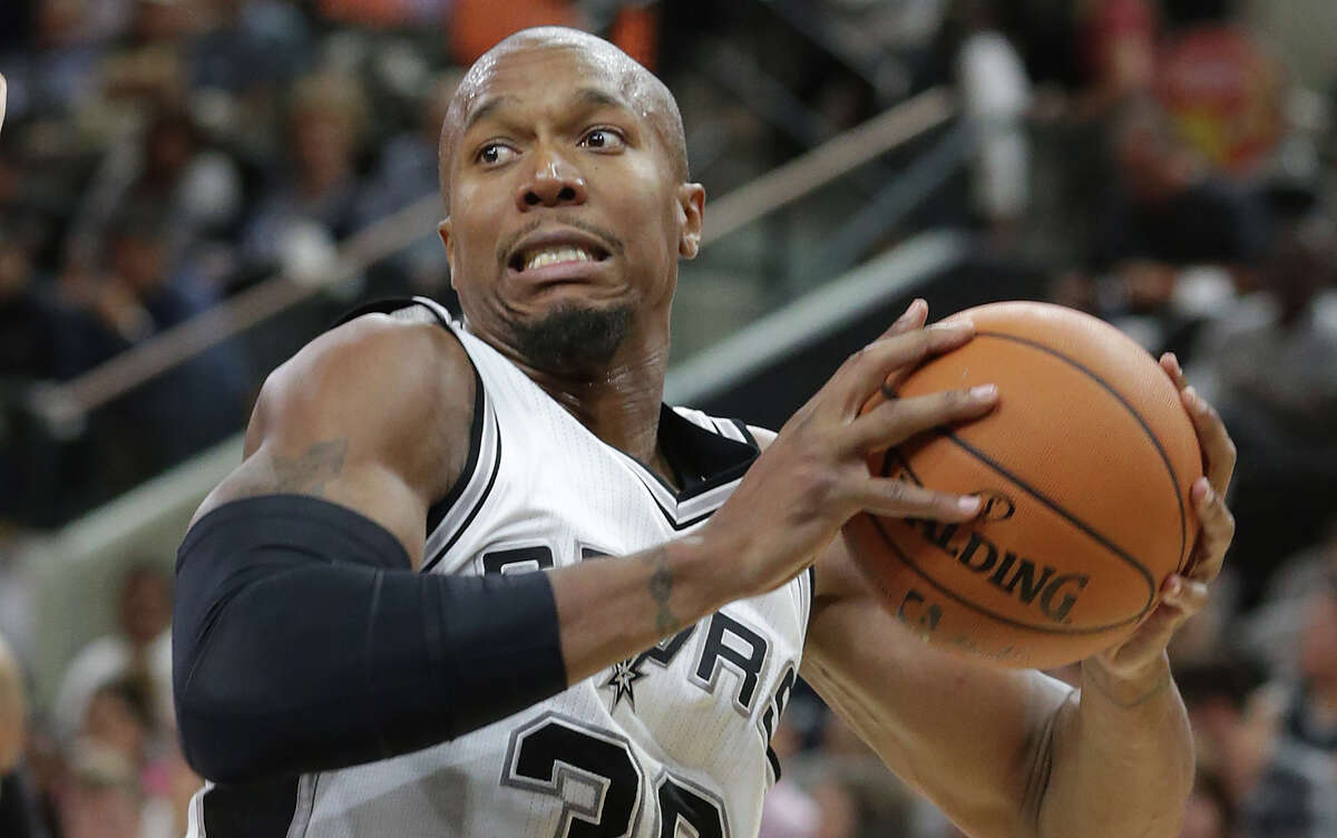 Spurs' David West looks to score against the Phoenix Suns at the AT&T Center on Oct. 20, 2015.