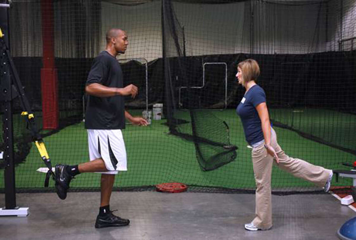 David West works out with a trainer.