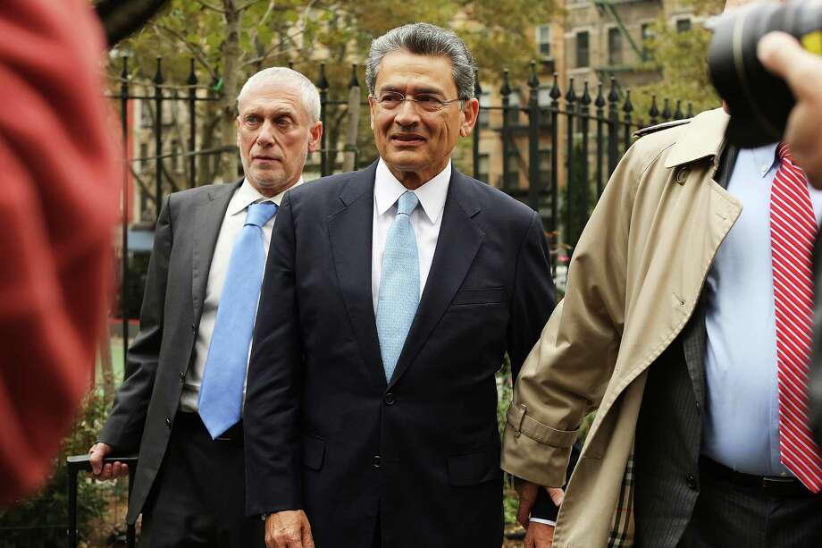 Westport resident Rajat Gupta, center, prior to his sentencing in October 2012 to a two-year prison sentence for feeding insider tips to hedge-fund manager Raj Rajaratnam. This year, the U.S. Court of Appeals for the Second Circuit ruled prosecutors must provide evidence that an individual was in a position to personally benefit to be convicted of insider trading. Photo: Spencer Platt / Spencer Platt /Getty Images / 2012 Getty Images