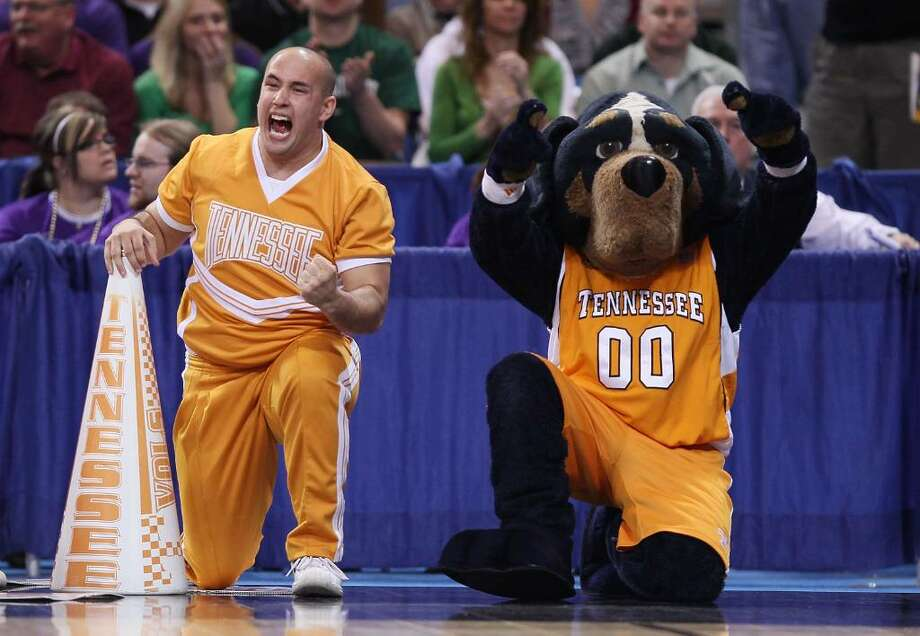 ST. LOUIS - MARCH 26:  Smokey, the Tennessee Volunteers mascot, and a cheerleader celebrate the win over he Ohio State Buckeyes during the midwest regional semifinal of the 2010 NCAA men's basketball tournament at the Edward Jones Dome on March 26, 2010 in St. Louis, Missouri. Tennessee defeated Ohio State 76-73. (Photo by Elsa/Getty Images) Photo: Elsa, Getty Images / 2010 Getty Images