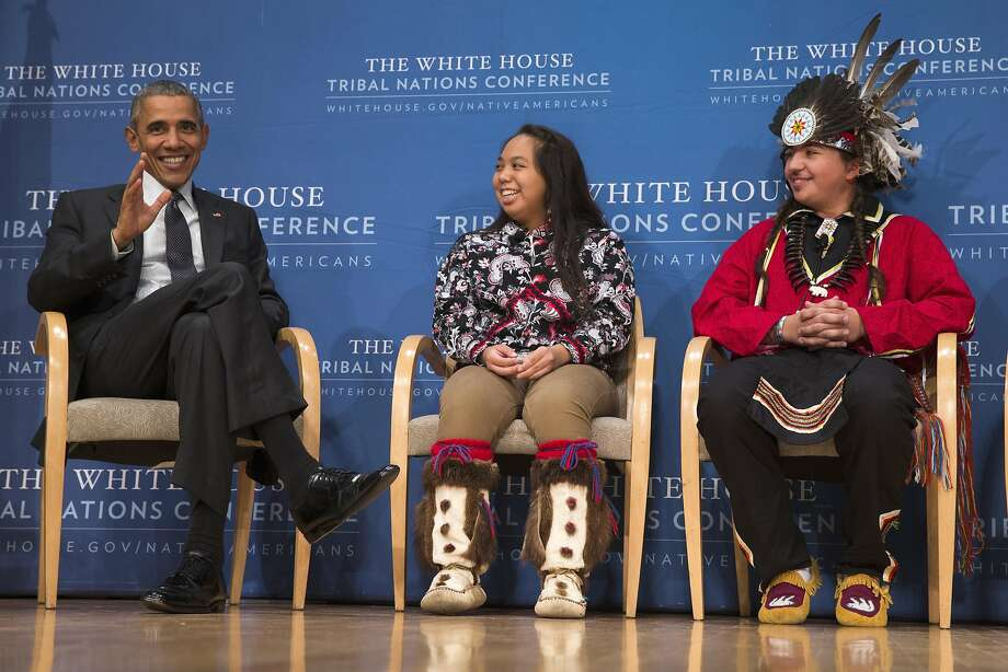 President Obama, shown with tribal leaders Brayden White (center) and Tatiana Ticknor, welcomes the gesture by Adidas. Photo: Evan Vucci, Associated Press