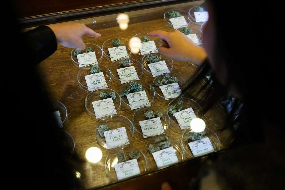 Monica Lo (right) and roommate Tiffany Wu (left), look at various strains of cannabis at their local dispensary on Post Street, in San Francisco, California on Friday, November 6, 2015. The duo are childhood friends who formed an organization called AsianAmericans for Cannabis, to help build support among the Asian community to support legalization. Photo: Gabrielle Lurie, Special To The Chronicle