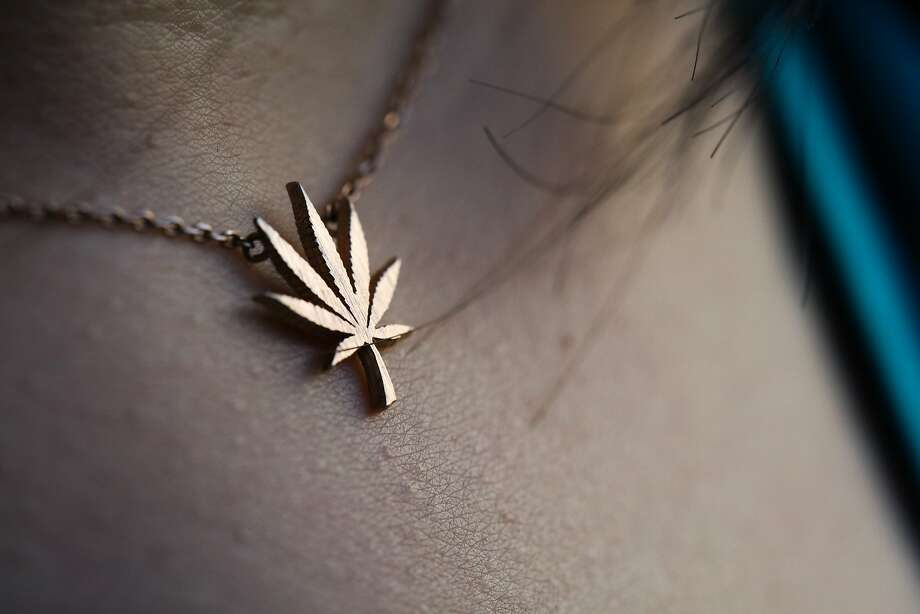 Tiffany Wu wears a necklace of a marijuana leaf that she purchased online, at Etsy, in San Francisco, California on Friday, November 6, 2015. Tiffany Wu and her roommate childhood friend Monica Lo (not pictured) formed an organization called AsianAmericans for Cannabis, to help build support among the Asian community to support legalization. Photo: Gabrielle Lurie, Special To The Chronicle