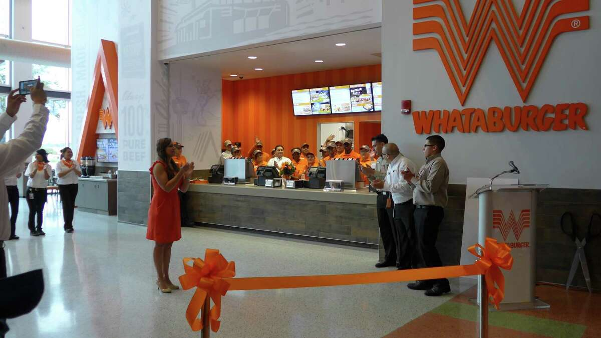 Employees of the new full-time Whataburger in the AT&T Center prepare for an opening ceremony on Friday, Nov. 6. The restaurant with its own exterior entrance operates on non-game days as well as game days, in answer to requests from workers and surrounding neighborhoods.