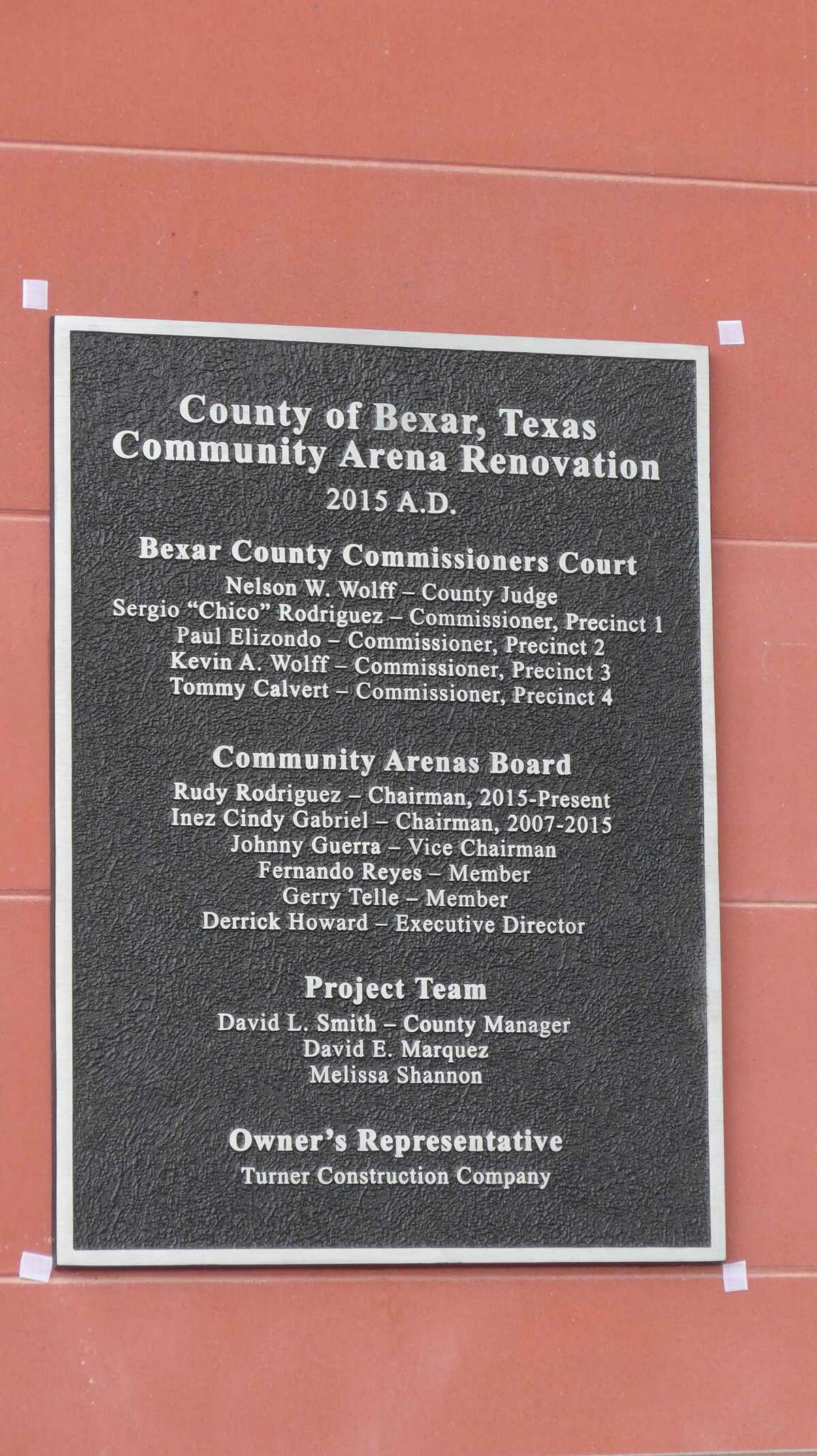 a plaque at the AT&T Center marking completion of a $111 million renovation. Bexar County Judge Nelson Wolff and other officials rededicated the facility on Friday, Nov. 6.
