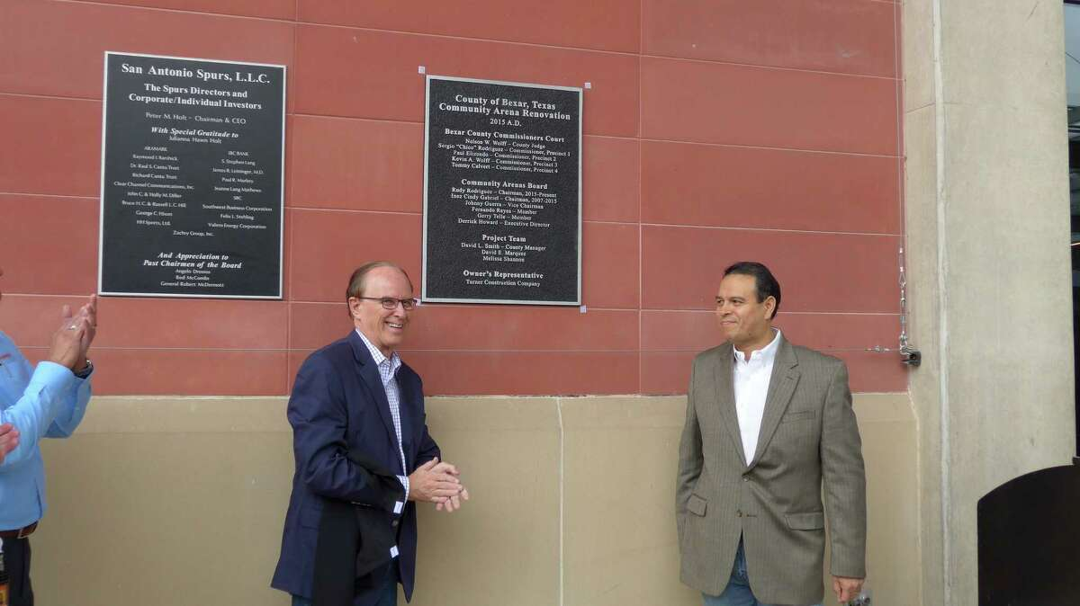 Bexar County Judge Nelson Wolff, left, and Community Arenas Board member Rudy Rodriguez unveil a plaque at the AT&T Center marking completion of a $111 million renovation, on Friday, Nov. 6.