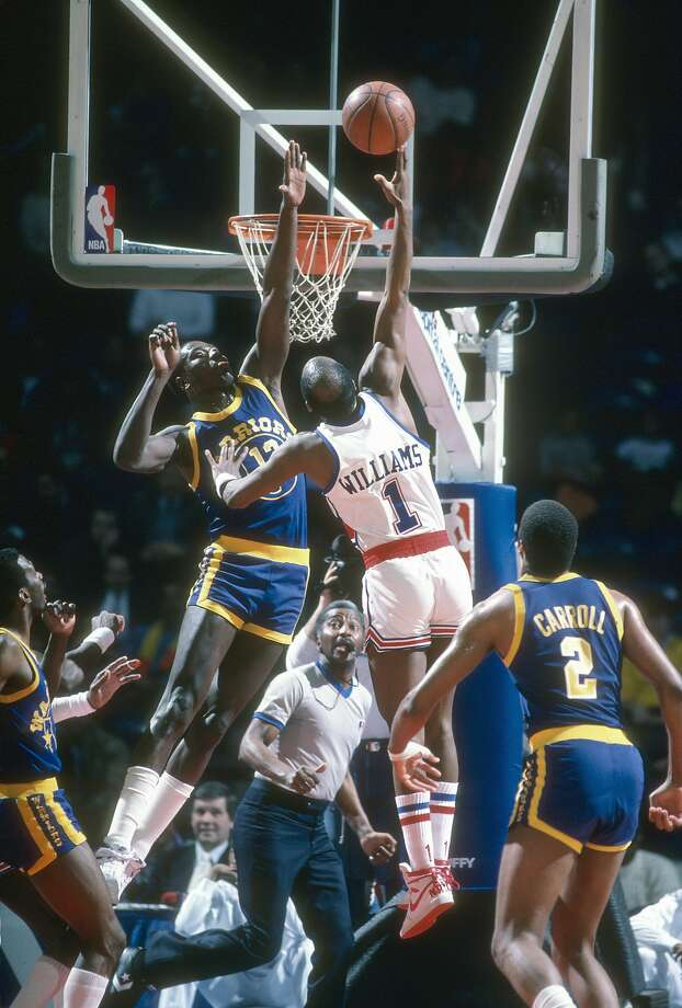 Gus Williams #1 of the Washington Bullets shoots over Larry Smith #13 of the Golden State Warriors during an NBA basketball game circa 1985 at the Capital Centre in Landover, Maryland. Williams played for the Bullets from 1984-86. Photo: Focus On Sport, Getty Images