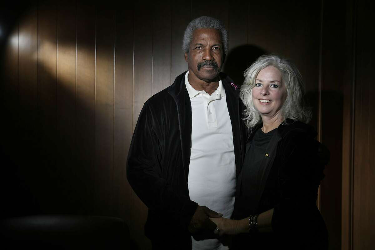 """Kermit Alexander, former 49er, and his wife Tami Alexander pose for a portrait on Friday, November 6, 2015 in San Francisco, Calif. Kermit Alexander's new book, ?'In the Valley of the Shadow of Death,?"""" tells the story of his journey after the murders of his mother, sister and two nephews in L.A. in 1984."""
