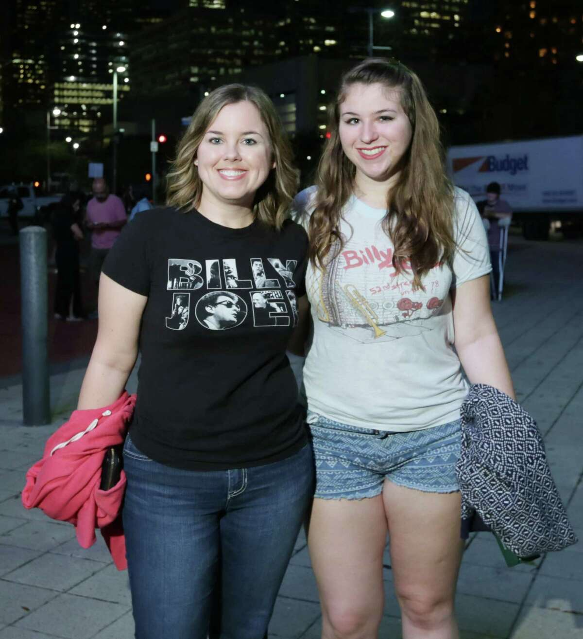 People pose for a photo before the Billy Joel concert at the Toyota Center Friday, Nov. 6, 2015, in Houston.