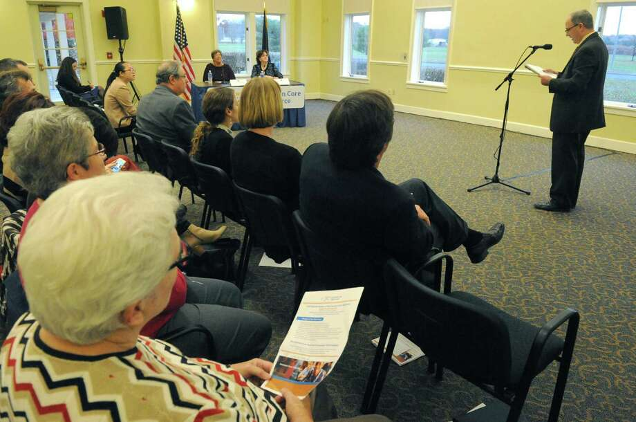 Tim Farley, right, of Columbia County with NYS Allies for Public Education speaks during a public hearing held by the New York State Common Core Task Force at The Crossings on Friday Nov. 6, 2015 in Colonie, N.Y.  (Michael P. Farrell/Times Union) Photo: Michael P. Farrell / 00034130A