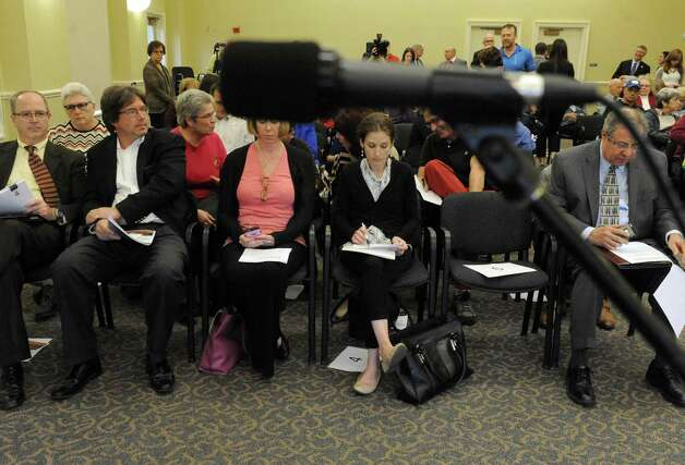 Speakers look over notes during a public hearing held by the New York State Common Core Task Force at The Crossings on Friday Nov. 6, 2015 in Colonie, N.Y.  (Michael P. Farrell/Times Union) Photo: Michael P. Farrell / 00034130A