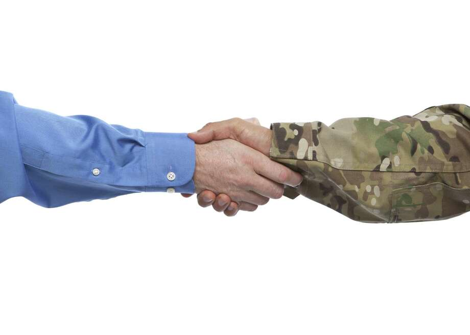 Military and Businessman Handshake Photo: Videodet / iStockphoto