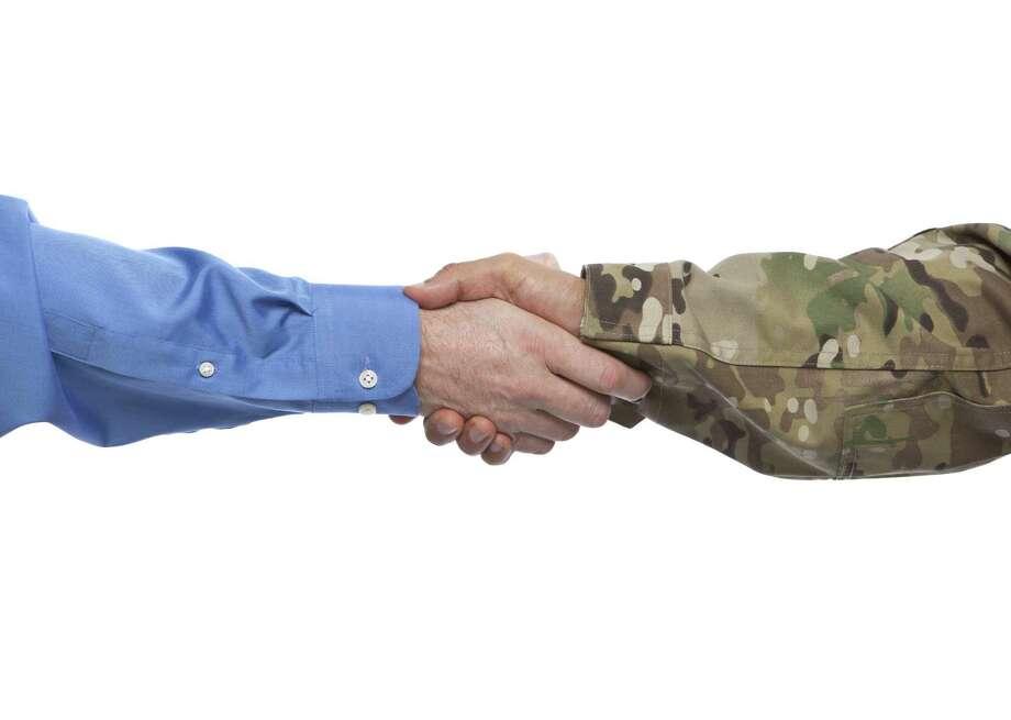 Military and Businessman Handshake Photo: Videodet / iStockphoto