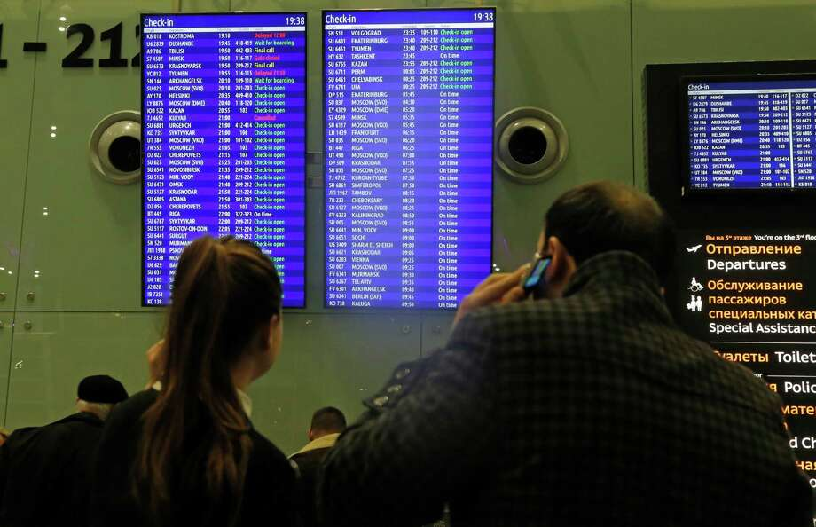 People look at flight information at Pulkovo airport outside St. Petersburg. Russia said it would bring home Russians in Egypt. Photo: Dmitry Lovetsky /Associated Press / AP