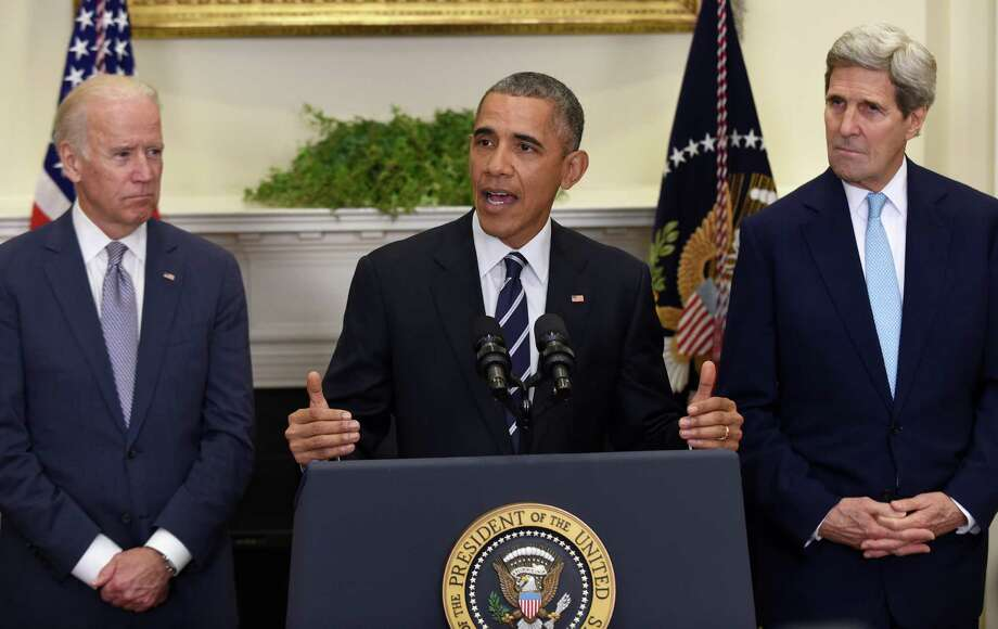President Barack Obama, accompanied by Vice President Joe Biden and Secretary of State John Kerry, announce he's rejecting the Keystone XL pipeline because he does not believe it serves the national interest, Friday Nov. 6, 2015, in the Roosevelt Room of the White House in Washington. (AP Photo/Susan Walsh) Photo: Susan Walsh, STF / AP
