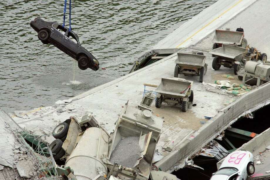 A car is pulled from the Mississippi River as work continued on the collapsed I-35W bridge in Minneapolis in 2007. Though Congress has passed 34 short-term highway spending bills since 2009, transportation experts say short-term fixes are limiting the ability of states to fix decaying structures that could pose a hazard to public safety. Photo: New York Times File Photo / NYTNS