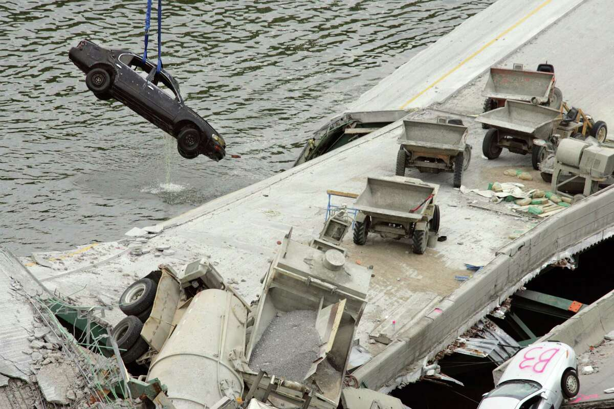 A car is pulled from the Mississippi River as work continued on the collapsed I-35W bridge in Minneapolis in 2007. Though Congress has passed 34 short-term highway spending bills since 2009, transportation experts say short-term fixes are limiting the ability of states to fix decaying structures that could pose a hazard to public safety.