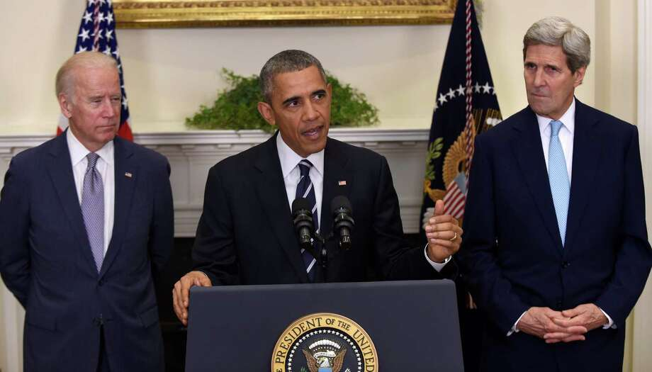 President Barack Obama, accompanied by Vice President Joe Biden and Secretary of State John Kerry, announces Friday he's rejecting the Keystone XL pipeline because he does not believe it serves the national interest. Photo: Susan Walsh /Associated Press / AP
