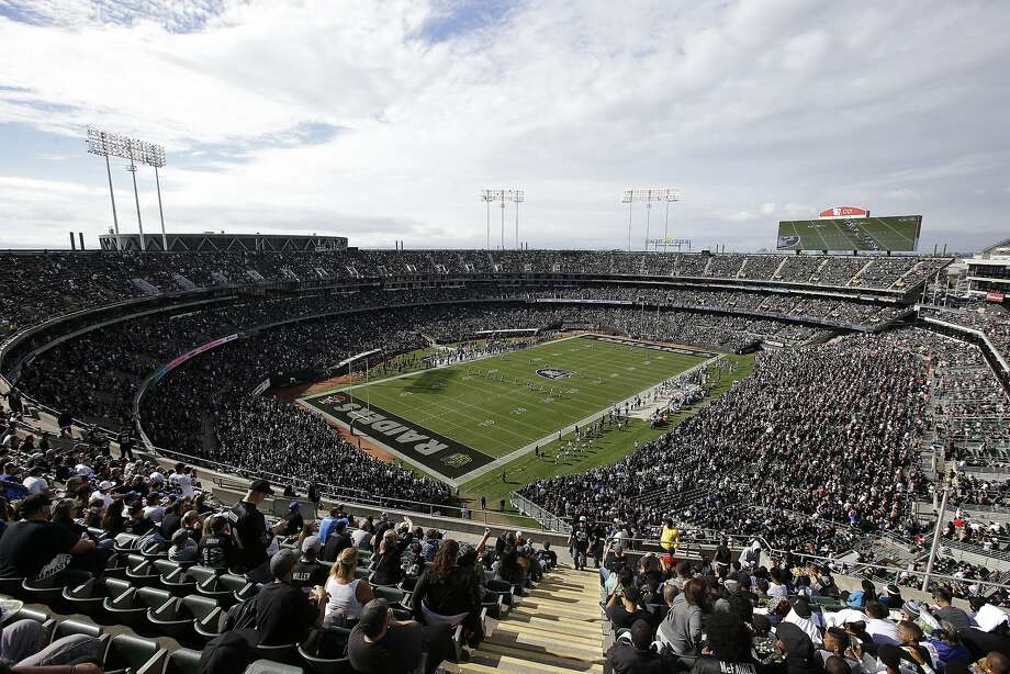 Fans watch from a general view of O.co Coliseum during the first half of the football game between the Oakland Raiders and the New York Jets in Oakland. Photo: Marcio Jose Sanchez, Associated Press