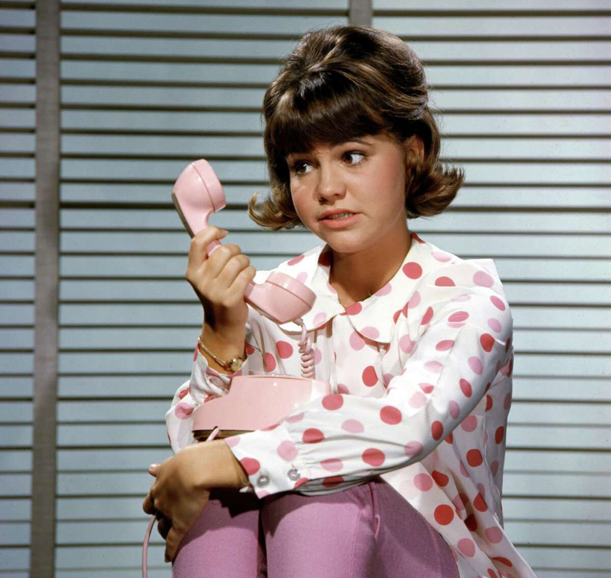 1965: Of course, Gidget had to have a pink Princess telephone, every bit as important to a talkative teenager in its time as an iPhone is now.