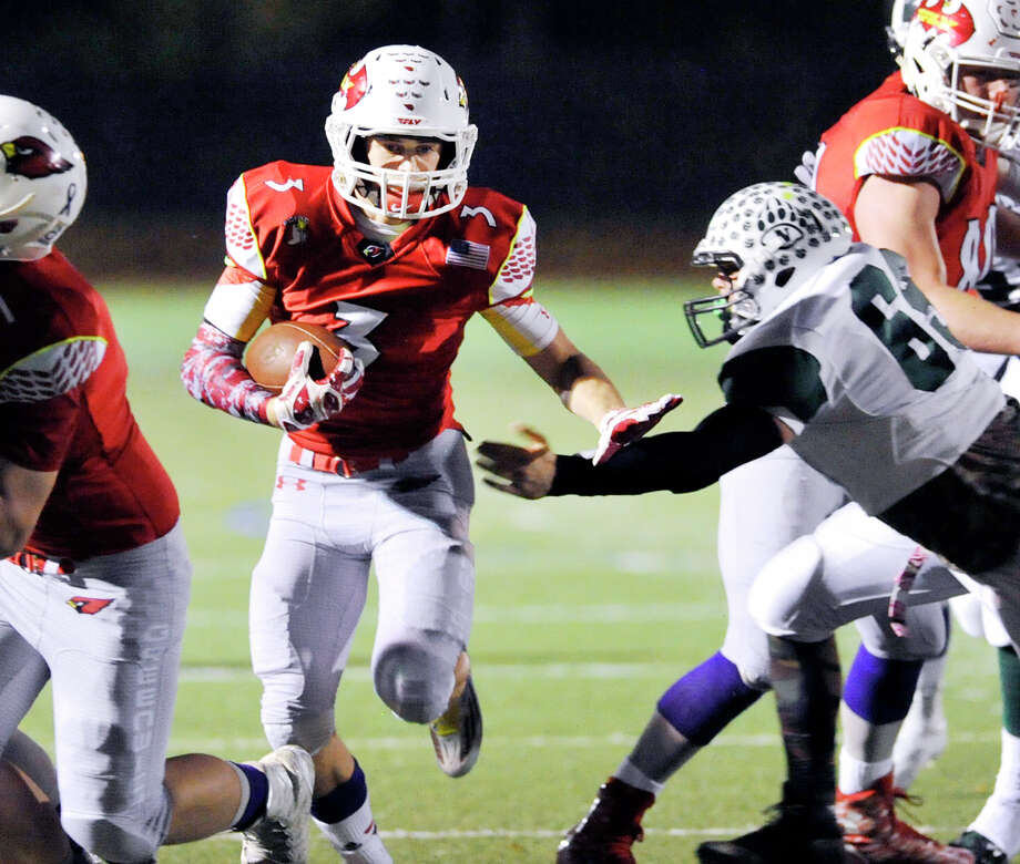At center, Greenwich running back Luke Bienstock (#3) finds the hole as he breaks a 20-yard run during the first quarter of the high school football game between Greenwich High School and Norwalk High School at Greenwich High School, Conn., Friday night, Nov. 6, 2015. Photo: Bob Luckey Jr. / Hearst Connecticut Media / Greenwich Time