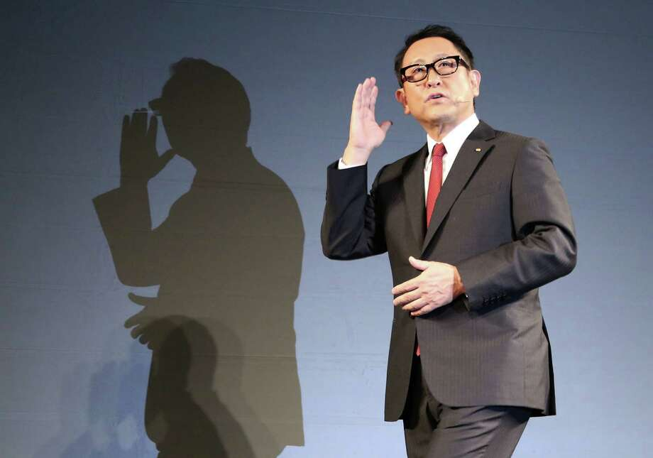 """At a press conference on artificial intelligence, President Akio Toyoda said, """"The goal is to do away with the tragedy of car accidents,"""" delivers a speech during a press conference on artificial intelligence in Tokyo, Friday, Nov. 6, 2015. Toyota is investing $1 billion in a research company it's setting up in Silicon Valley to develop artificial intelligence and robotics, underlining the Japanese automaker's determination to lead in futuristic cars that drive themselves and apply the technology to other areas of daily life. (AP Photo/Eugene Hoshiko) Photo: Eugene Hoshiko / Associated Press / AP"""