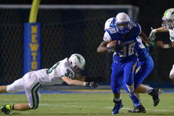 Photographs from the  football game between New Milford and Newtown high schools, Friday night, November 6, 2015, at Newtown High School, Newtown, Conn.
