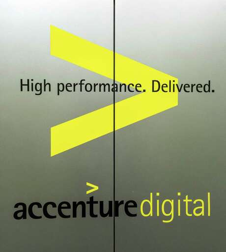 Accenture, 1301 Fannin Street. Accenture builds flexibility into schedules and work environments encouraging virtual work and non-traditional schedules. ID: Graphics on elevator doors. Friday  September 18, 2015  (Craig H. Hartley/For the Chronicle)