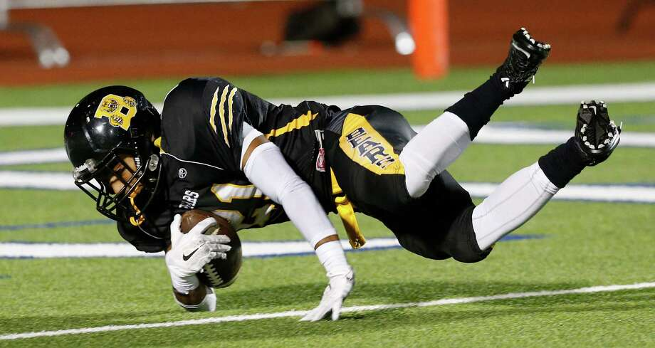 Brennan's Isaiah Paul (21) flips into the end zone for a late second quarter score against O'Connor during their game at Gustafson Stadium on Friday, Nov. 6, 2015. Photo: Kin Man Hui, San Antonio Express-News / ©2015 San Antonio Express-News