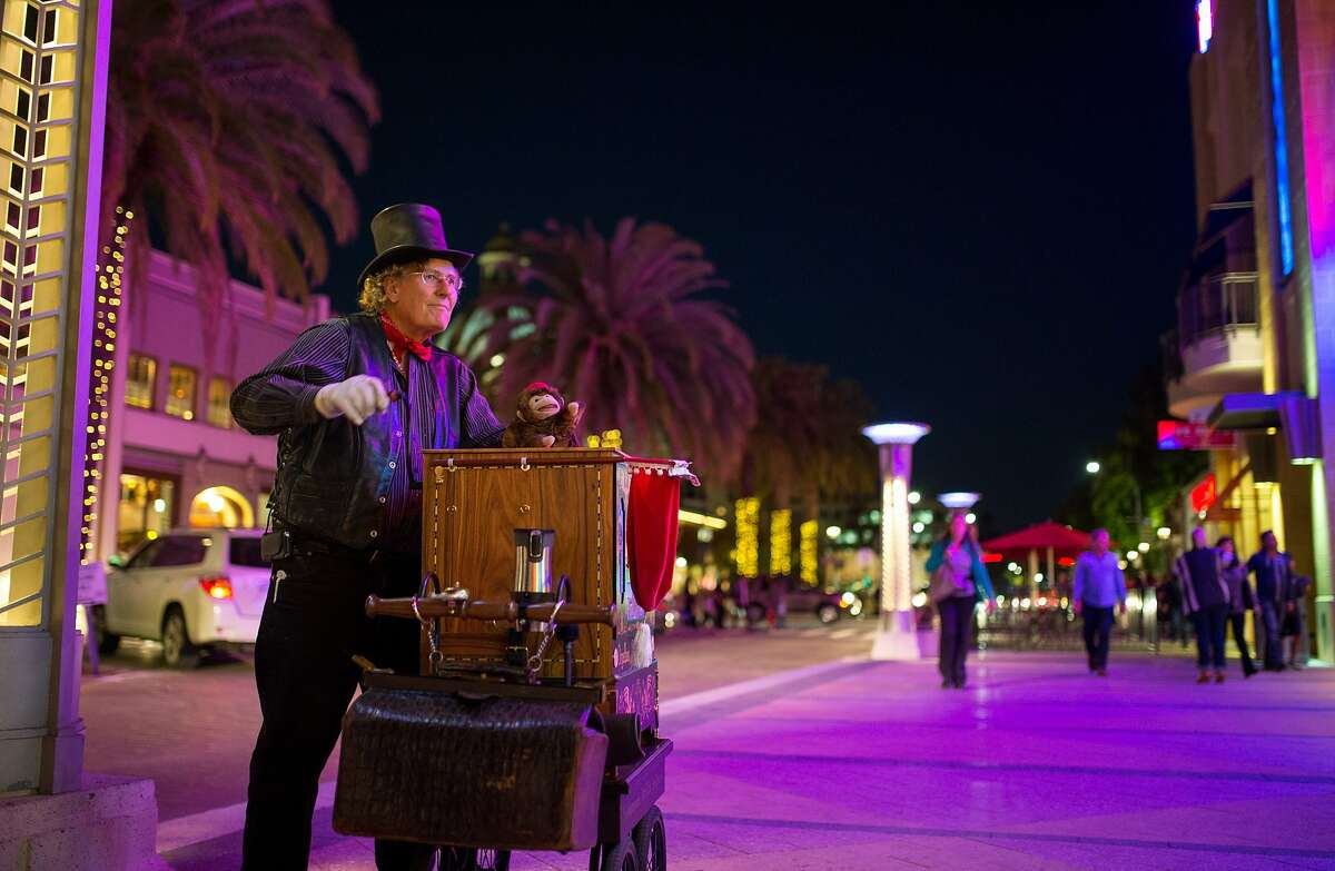 Darryl Coe plays his street organ on Middlefield Road near Broadway on Friday, Nov. 6, 2015 in Redwood City, Calif.