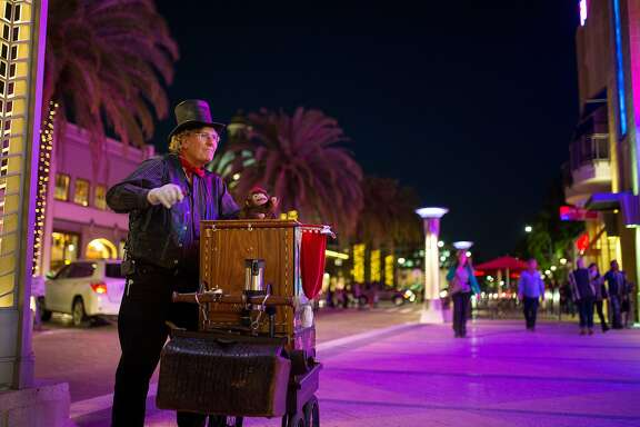 Darryl Coe plays his street organ on Middlefield Road near Broadway on Friday, Nov. 6, 2015 in Redwood City, Calif.