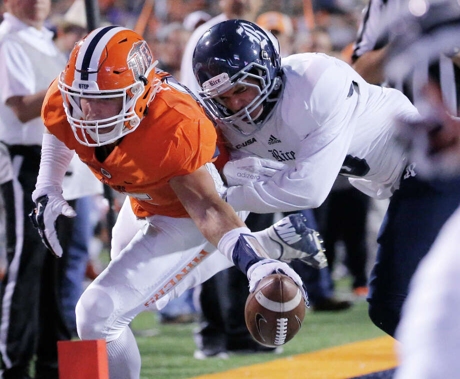 Rice safety JP Thompson keeps UTEP tight end Hayden Plinke out of the end zone during the first half of an NCAA college football game Friday, Nov. 6, 2015, in El Paso, Texas. (Mark Lambie/El Paso Times via AP) Photo: Mark Lambie, Associated Press / El Paso Times