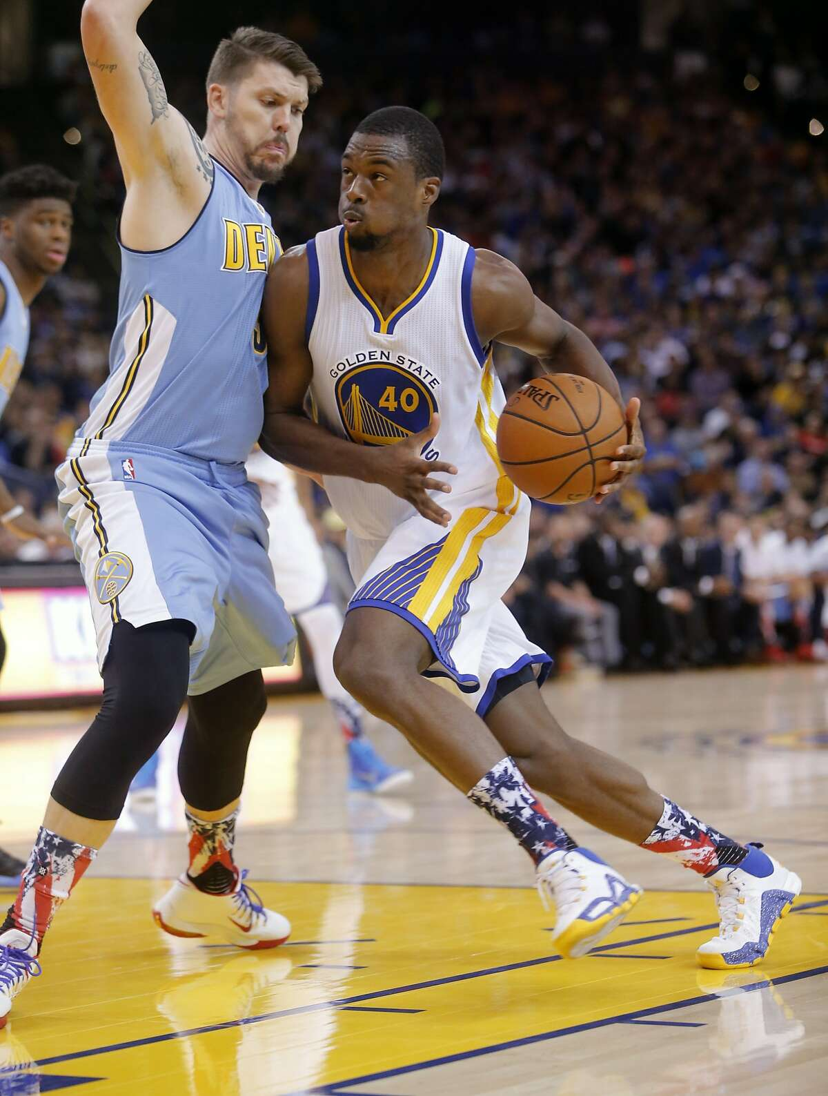 Warriors' Harrison Barnes, 40 drives inside the Nuggets' MIke Miller, 3 as the Golden Sate Warriors take on the Denver Nuggets at the Oracle Arena in Oakland, Calif. on Fri. November 6, 2015.