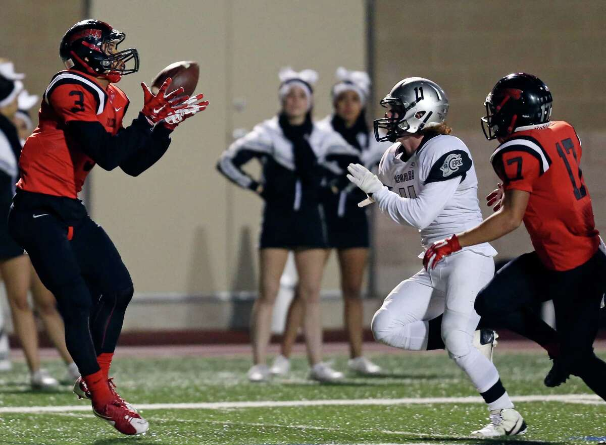 Stevens' Devin Martin catches a pass around Clark's Cooper Morgan as Stevens' Joshua Shelley looks on during first half action Friday Nov. 6, 2015 at Farris Stadium. Martin scored a touchdown on the play.
