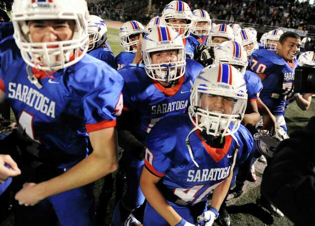 Saratoga celebrates their 19-14 win over Shaker in the Class AA football championship game on Friday, Nov. 6, 2015, at Shenendehowa High in Clifton Park, N.Y. (Cindy Schultz / Times Union) Photo: Cindy Schultz / 00034111A