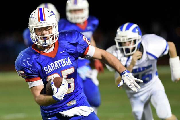 Saratoga's Dakota Harvey, left, carries the ball during their Class AA football championship game against Shaker on Friday, Nov. 6, 2015, at Shenendehowa High in Clifton Park, N.Y. (Cindy Schultz / Times Union) Photo: Cindy Schultz / 00034111A