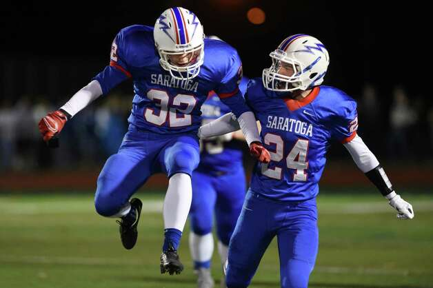 Saratoga's Richard Cholnoky, left, and Nick Ingles celebrate points on the board during their Class AA football championship game against Shaker on Friday, Nov. 6, 2015, at Shenendehowa High in Clifton Park, N.Y. (Cindy Schultz / Times Union) Photo: Cindy Schultz / 00034111A